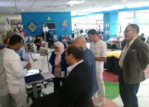 وفد من جامعة أسيوط يزور مستشفى سرطان الأطفال لبدء خطة التعاون المشترك