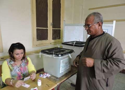 """قوات الأمن تحذر مندوبي مرشح الوفد بـ""""أوسيم"""" من توجيه الناخبين"""