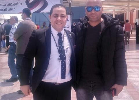 أجواء احتفالية أمام لجان الاستفتاء بمطار القاهرة الدولي
