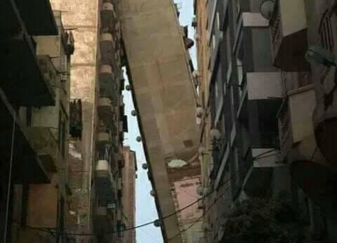 إنزال أثاثات العقار المائل بالإسكندرية بمعرفة الحماية المدنية