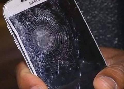 بالصور| هاتف محمول ينقذ صاحبه من تفجيرات باريس
