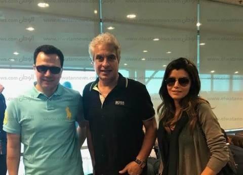 وائل الإبراشي وإيمان الحصري يغادران مطار القاهرة إلى شرم الشيخ