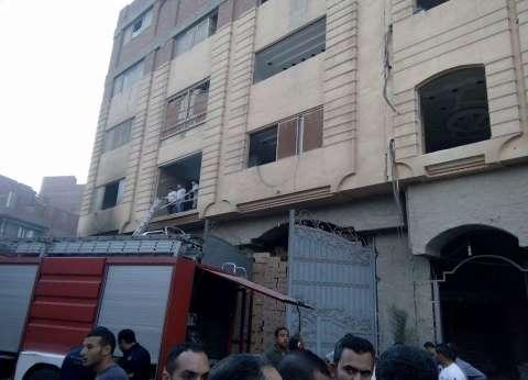 أمن الجيزة يسيطر على حريق شقة في إمبابة
