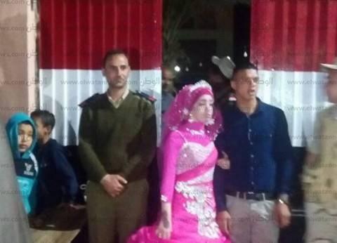 بالصور| عروسان يدليان بصوتهما في اللحظات الأخيرة بالدقهلية