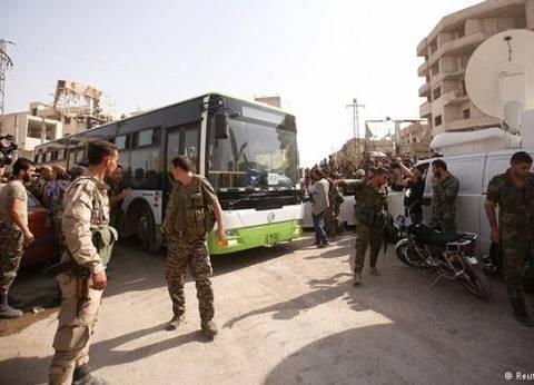 """وصول أول دفعة من مقاتلي """"داريا"""" إلى مدينة أدلب في شمال غرب سوريا"""