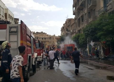 بالصور| السيطرة على حريق بأسطح 3 عقارات في مصر الجديدة