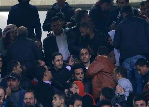 جمال وعلاء مبارك يحضران مباراة مصر وأوغندا بملعب برج العرب