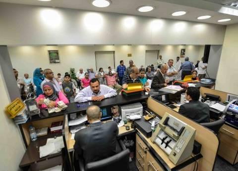 «الأهلى المصرى» يمد ساعات العمل فى 65 فرعاً حتى الخامسة مساءً لسداد مستحقات الضرائب