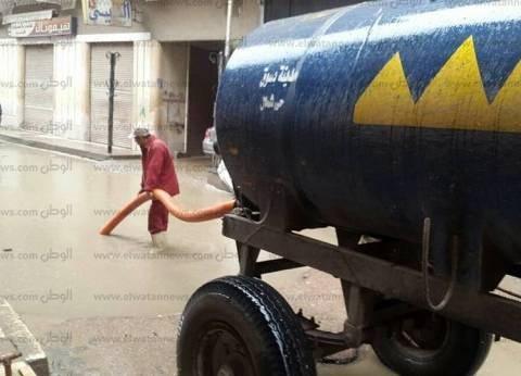 بالصور| طوارئ في كفر الشيخ وشفط مياه الأمطار من شوارع دسوق