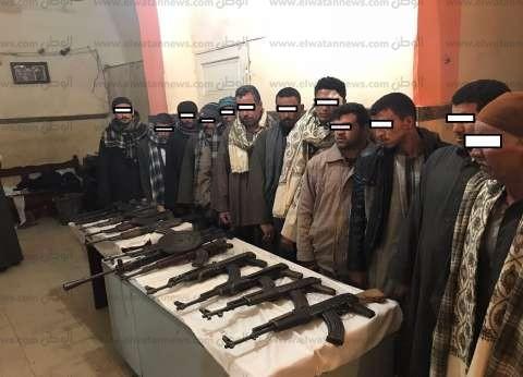 """ضبط 12 قطعة سلاح بينها """"رشاش جرينوف"""" بحوزة طرفي خصومة بأسيوط"""