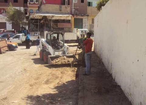 حملة نظافة حول أسوار المدارس بالغردقة