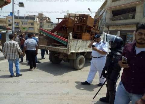 """""""المرافق"""" تشن حملة إزالة في شارع سعد زغلول وسط الإسكندرية"""