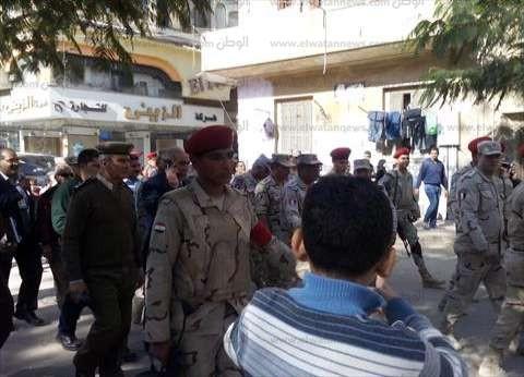 """قوات الأمن تتدخل في """"البساتين"""" بعد مشادات بالأيدي بين مندوبي المرشحين"""