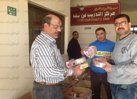 """بالصور  """"تعليم جنوب سيناء"""" توزع 330 علبة حلوى المولد"""