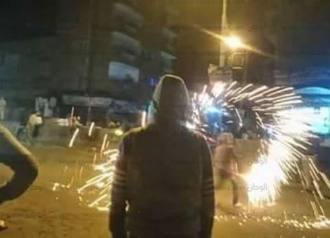 """شباب الفيوم يرفعون أعلام مصر ويطلقون الألعاب النارية احتفالا بفوز """"الفراعنة"""""""