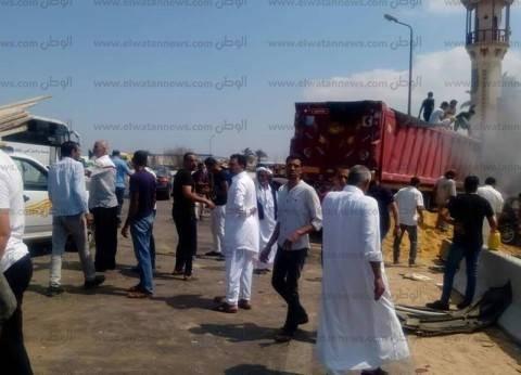 إصابة 21 شخصا في تصادم بين سيارتي نقل وأجرة بسوهاج