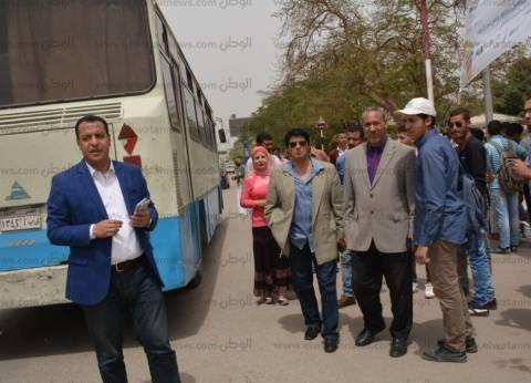 أتوبيسات لنقل طلاب جامعة أسيوط للمشاركة في الانتخابات