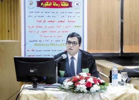 باحث فى «إعلام القاهرة» يهدى «دكتوراه» إلى أرواح الشهداء