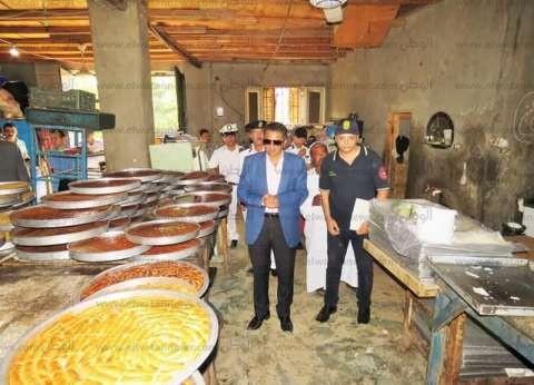 مدير أمن الإسماعيلية يداهم مصنع حلويات دون ترخيص ويضبط نص طن