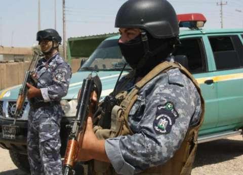 """إصابة شرطيين إثر اقتحام مسلحين مبنى """"أربيل"""" بالعراق"""
