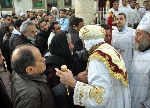 بالصور| الكنيسة تُحيي ذكرى الأربعين لشهيدي حلوان في أسيوط