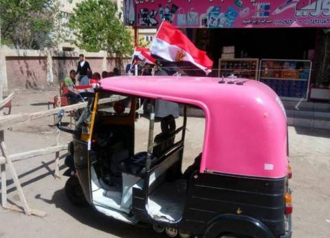 """سائقو """"السيارات"""" و""""التوك توك"""" يتطوعون لنقل الناخبين بكفر الشيخ"""