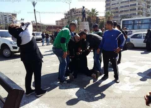 أسر المتهمين يحتجون أمام مديرية أمن بورسعيد