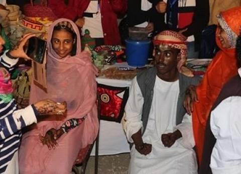 بالصور| حلايب وشلاتين وأبو رماد تقدم طقوس الفرح النوبي في معرض الكتاب