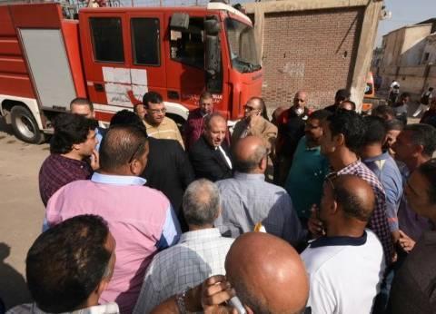 السيطرة على حريق بسيارة أمام قسم شرطة إمبابة