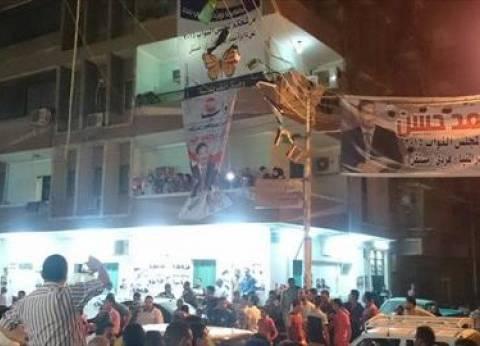 """أنصار مرشح """"يحتفلون بفوزه"""" قبل انتهاء فرز الأصوات بالمنيا"""