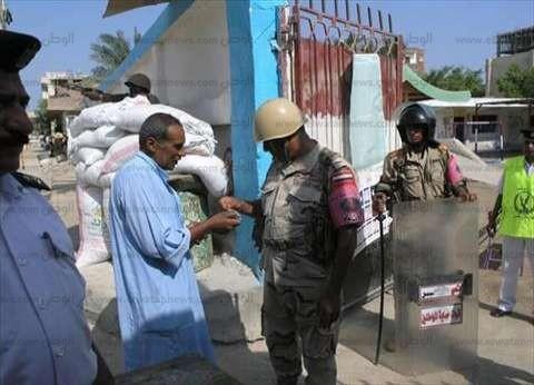 ضبط أحد أنصار مرشح يوجه الناخبين في دمنهور