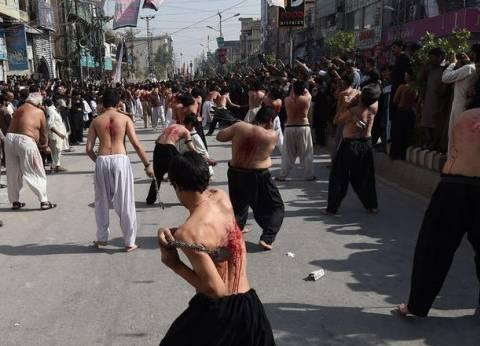 """بالصور  الشيعة يحيون ذكرى """"عاشوراء"""" في أنحاء العالم بالسيوف والدم"""