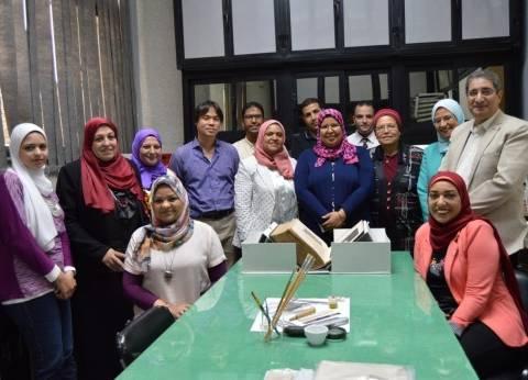 """جامعة عين شمس تحتفل بانتهاء ترميم 1300 صفحة من كتاب """"أبقراط في الطب"""""""