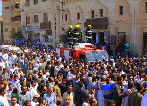 بالصور  الآلاف يشيعون جثماني شهيدي حادث إسنا الإرهابي