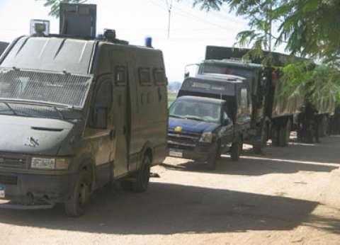 تكثيف أمني بمحيط مستشفى أسيوط الجامعي عقب وصول جثث 13 إرهابيا