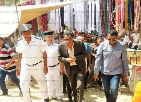 بالصور| مدير أمن الإسماعيلية يتابع نقل 2000 بائع لمنطقة السوق الجديدة