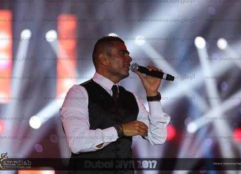 بالصور| عمرو دياب يحيي حفلا غنائيا ضخما في دبي برأس السنة