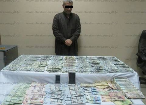 القبض على صاحب محل لبيع الهواتف المحمولة بالدقهلية يتاجر في العملات الأجنبية