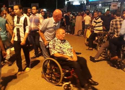 سائح من ذوي الاحتياجات الخاصة يحتفل بصعود مصر لكأس العالم