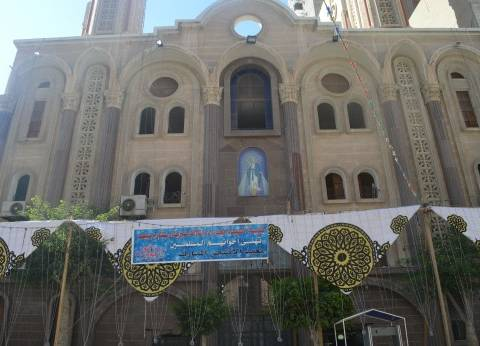 بالصور| كنيسة العذراء في الإسكندرية تعلق لافتات تهئنة بعيد الأضحى