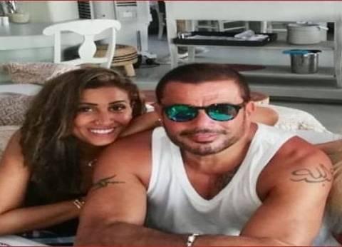 دينا الشربيني بملابس مثيرة بصحبة عمرو دياب في أحدث صورة لهما