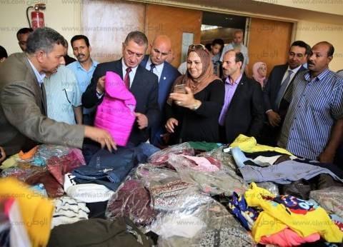 بالصور| توزيع 1200 قطعة ملابس على الأسر الأولى بالرعاية في كفر الشيخ