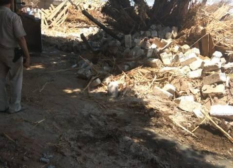 إزالة التعديات على أرض تابعة لمركز شباب أسيوط