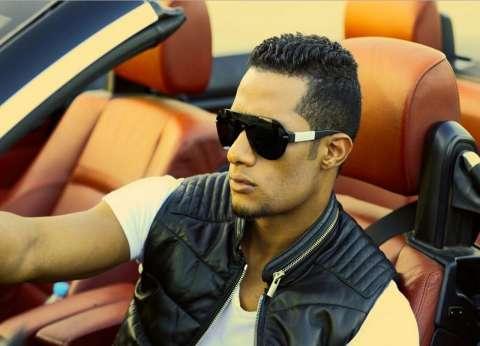 """محمد رمضان ينشر صورته مع لاعب الأهلي أحمد فتحى على """"فيس بوك"""""""