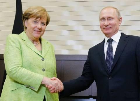 بوتين وميركل مستعدان لدعم استئناف جهود تسوية الأزمة السورية