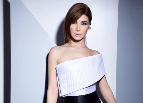 نانسي عجرم تنشر صورتها مع زوجها في عرض أزياء بباريس