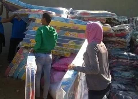 استمرار توزيع المساعدات لمتضرري السيول في رأس غارب