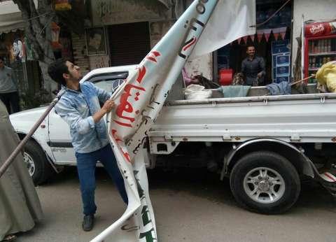 حملة لإزالة الإعلانات المخالفة بنطاق حي وسط في الإسكندرية