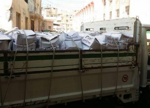 القوات المسلحة توزع 700 كرتونة سلع غذائية على أهالى الروضة