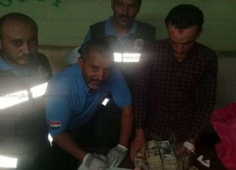 مسعف وسائق يسلمان 145 ألف جنيه عثرا عليها بجوار مصابين في بني سويف